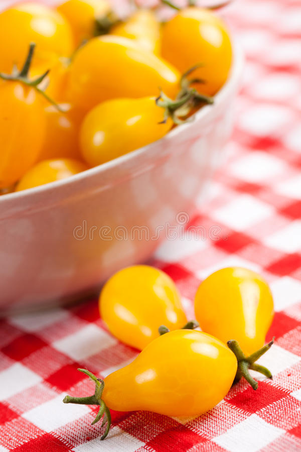 Download Yellow Tomatoes On Picnic Tablecloth Stock Image - Image: 15850715
