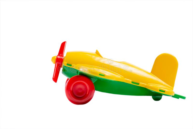 Yellow toy airplane with propeller and landing gear isolate on a white background without shadow. The concept of travel and flight royalty free stock photography