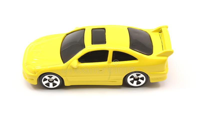 Yellow toy car coupe. On a white background royalty free stock photography