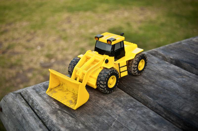 Yellow toy front-loader truck stock image