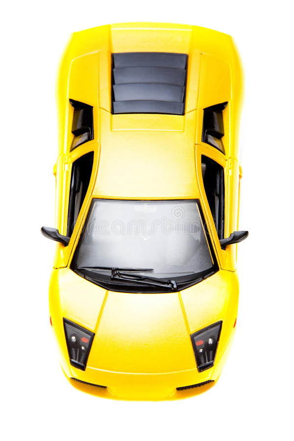 Yellow toy sport car. Yellow toy sportcar isoladed over white background stock photography
