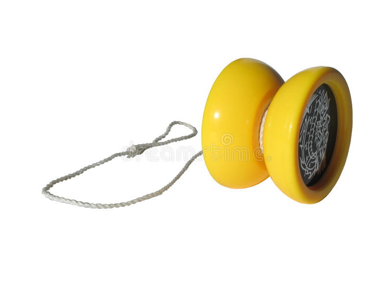Yellow toy yo-yo. Yellow toy yo-yo on a white background. Clipping stock photography