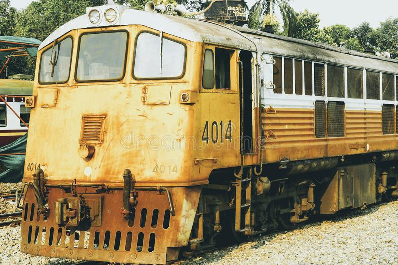 Yellow train, Thailand train. Procession yellow Train led by diesel electric locomotive on the tracks from Thailand stock photos