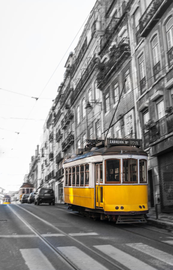 Yellow Tram in motion, Lisbon, Portugal royalty free stock photography
