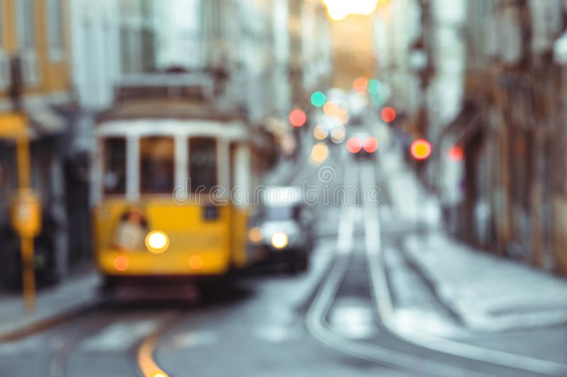 Yellow tram of the Route 28 on the street of Lisbon stock image