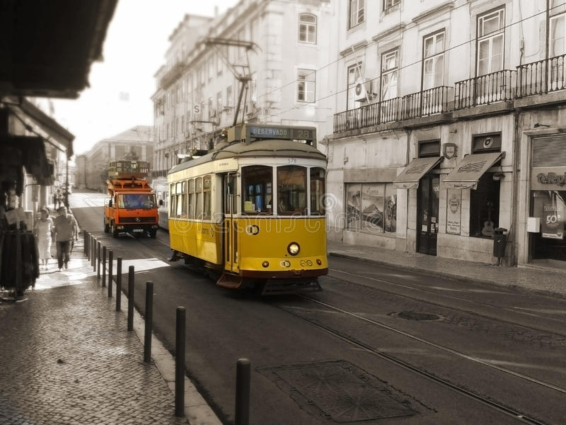 Yellow Tram and Vehicle circulating in Lisbon, Portugal. Yellow Tram and Vehicle circulating in a street of Lisbon, Portugal royalty free stock photos