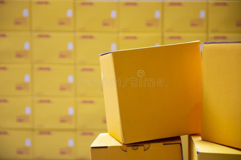 Yellow transportation boxes packages. Are seen arranged in a warehouse stock image