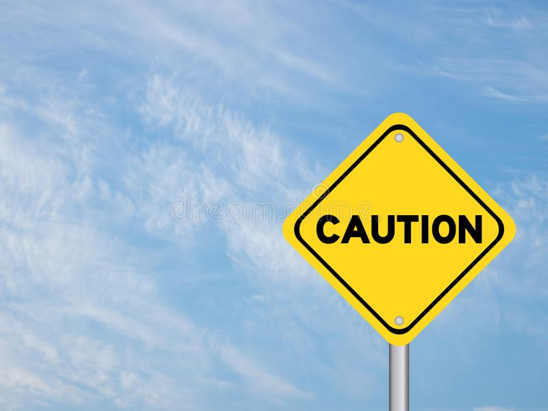 Yellow transportation sign post with caution word royalty free stock image