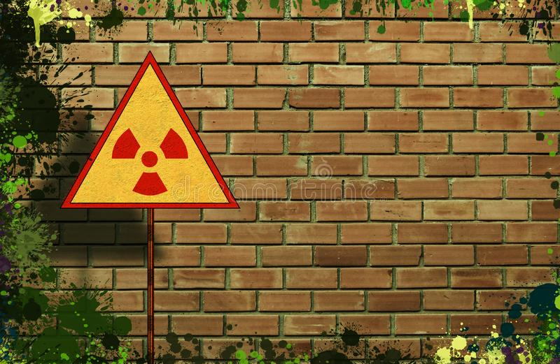 Yellow triangle sign with an international Radioactive Symbol on messy and dirty brick wall background. Digital mock-up. With free copy space for artwork or royalty free stock images