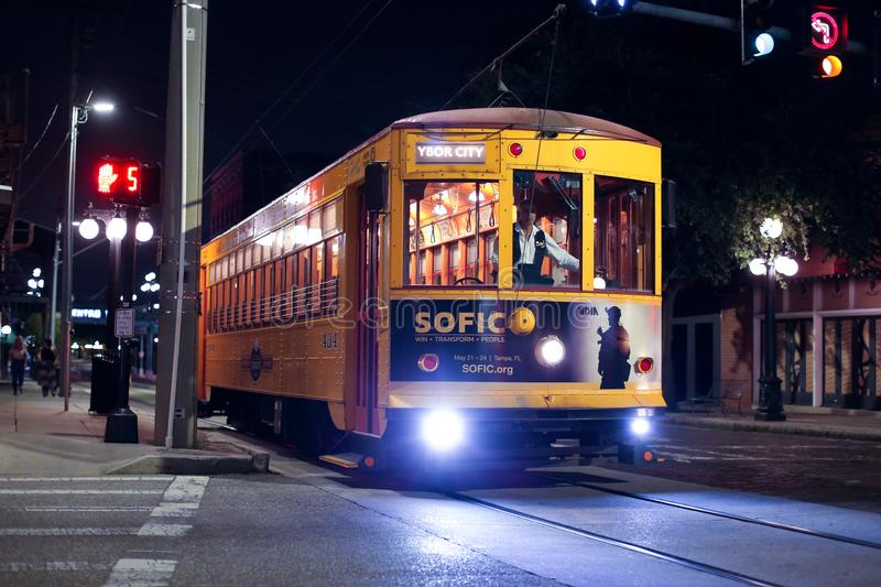 Yellow trolley driving in Ybor city at night right outside downtown Tampa, Florida - USA - May 23, 2018 stock photo