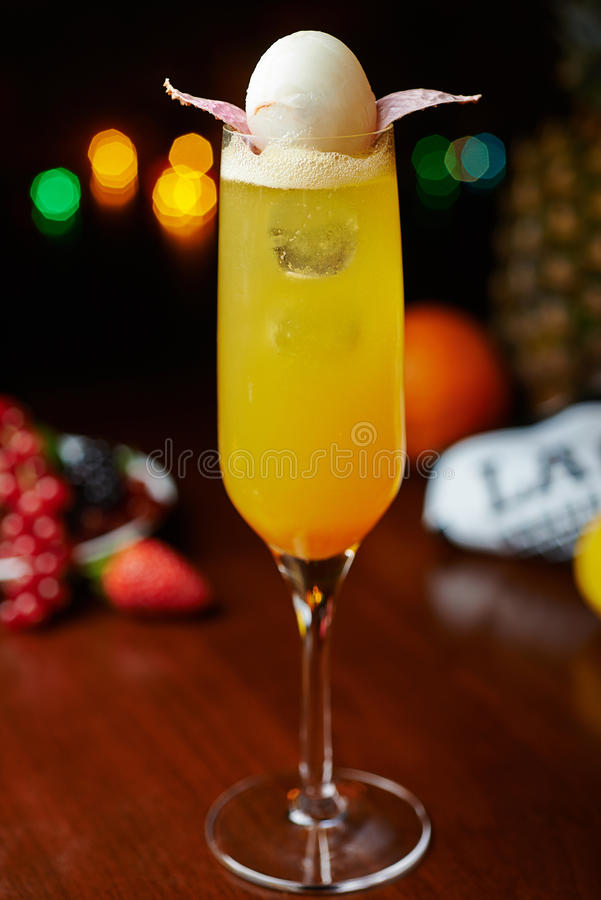 Yellow tropical alcohol cocktail or lemonade with decoration. royalty free stock photography