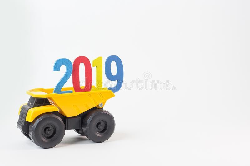 The Yellow truck hold 2019 number on white background. Yellow truck hold 2019 number on white background stock photos