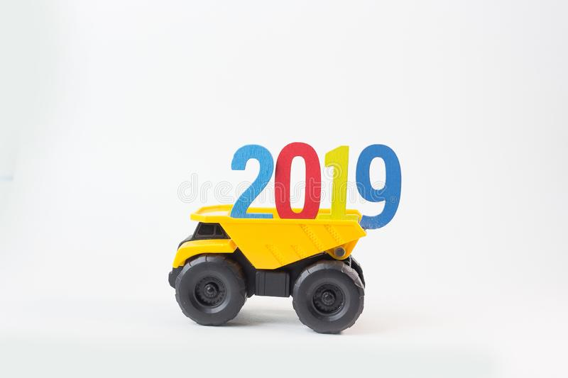 The Yellow truck hold 2019 number on white background. Yellow truck hold 2019 number on white background royalty free stock photo