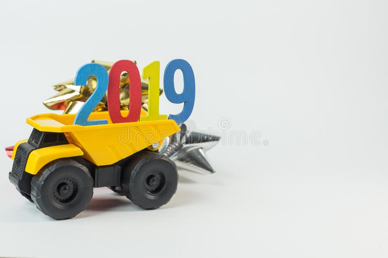 The Yellow truck hold 2019 number on white background. Yellow truck hold 2019 number on white background royalty free stock photography