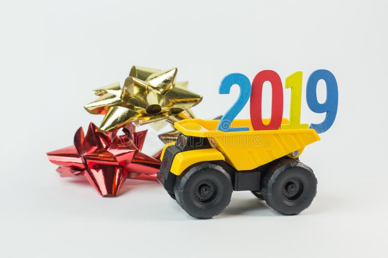 The Yellow truck hold 2019 number on white background. Yellow truck hold 2019 number on white background royalty free stock images