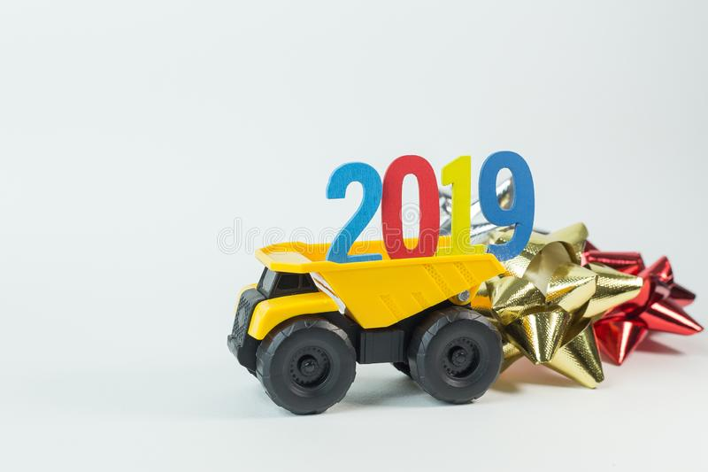 The Yellow truck hold 2019 number on white background. Yellow truck hold 2019 number on white background stock images