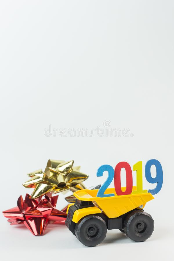 The Yellow truck hold 2019 number on white background. Yellow truck hold 2019 number on white background royalty free stock image