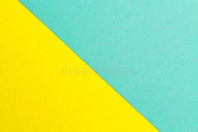 Yellow and turquoise paper texture background Color. Trending colors, geometric background of the paper. Colorful soft paper backg. Round.Pastel color stock image