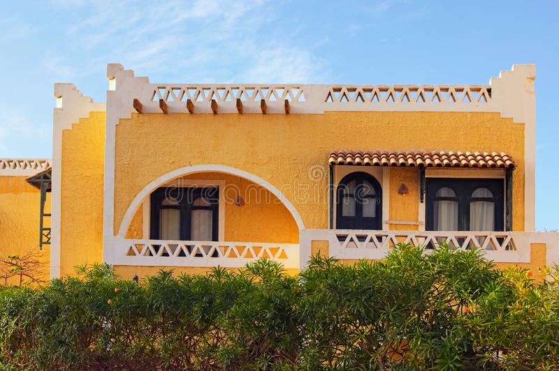 Yellow two-storey hotel building in the Arabic style. Tourist resort near the Red Sea. Summer vacation concept. Sinai peninsula, Sharm Al Sheikh, Egypt royalty free stock images