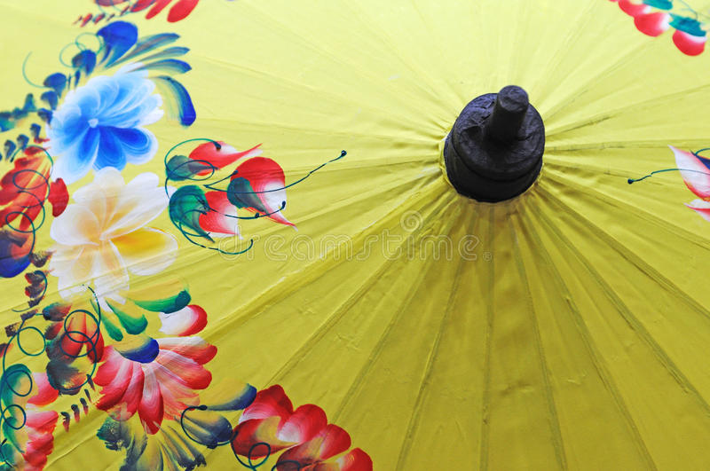 Yellow umbrella. Details of Chinese traditional yellow umbrella stock photography