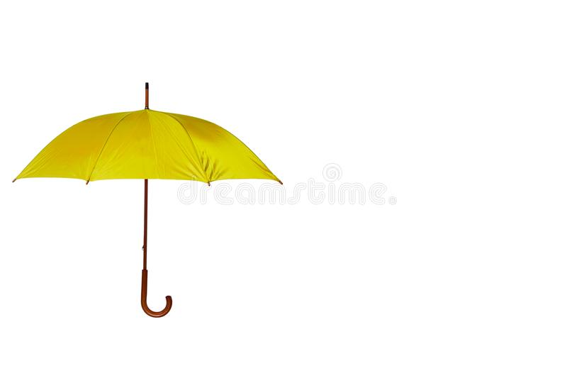 Yellow Umbrella Off Center on White Background. Yellow Umbrella with Wooden Curved Handle Off Center on White Background royalty free stock photography