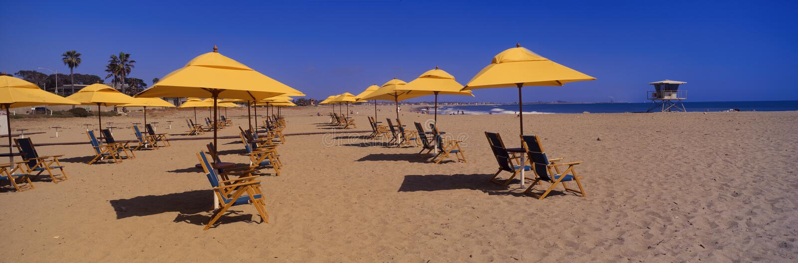 Download Yellow Umbrellas And Beach Chairs Stock Photo - Image: 23176376