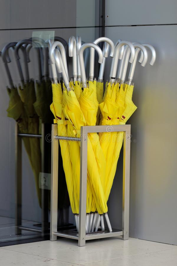 Free Yellow Umbrellas Stand In A Silver Basket In The Hotel Lobby Stock Photography - 109499392