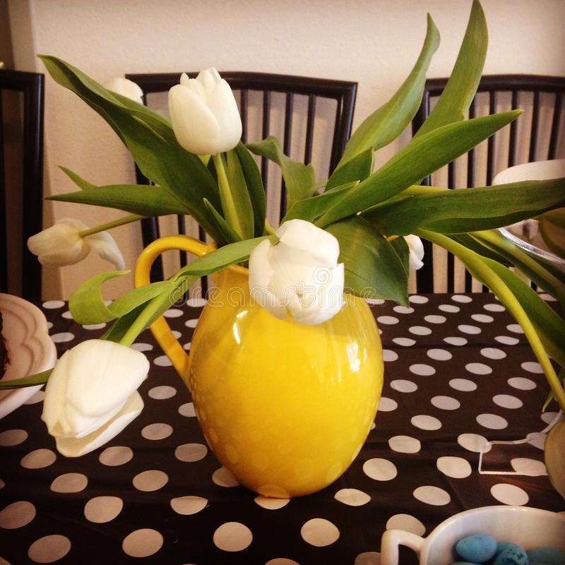 Yellow Vase with White Tulips stock images