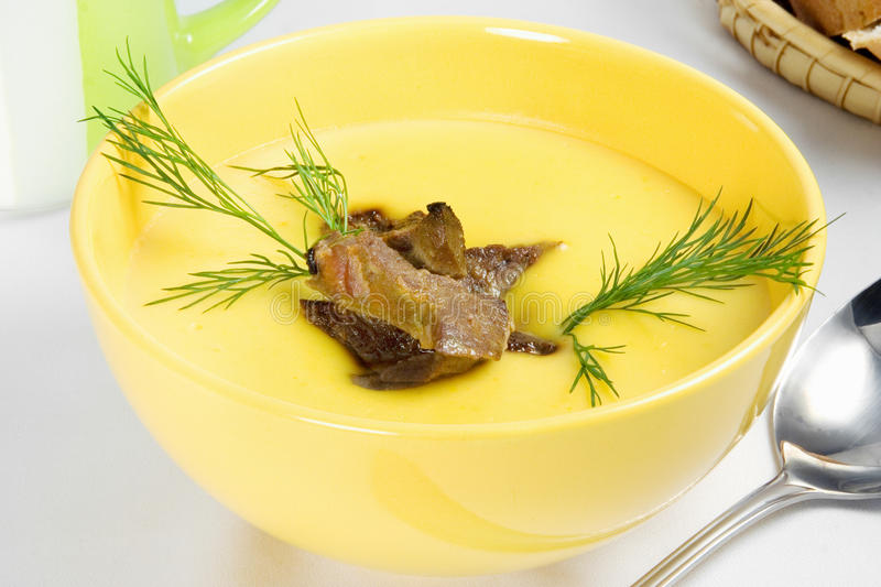 Yellow vegetable cream soup with meat