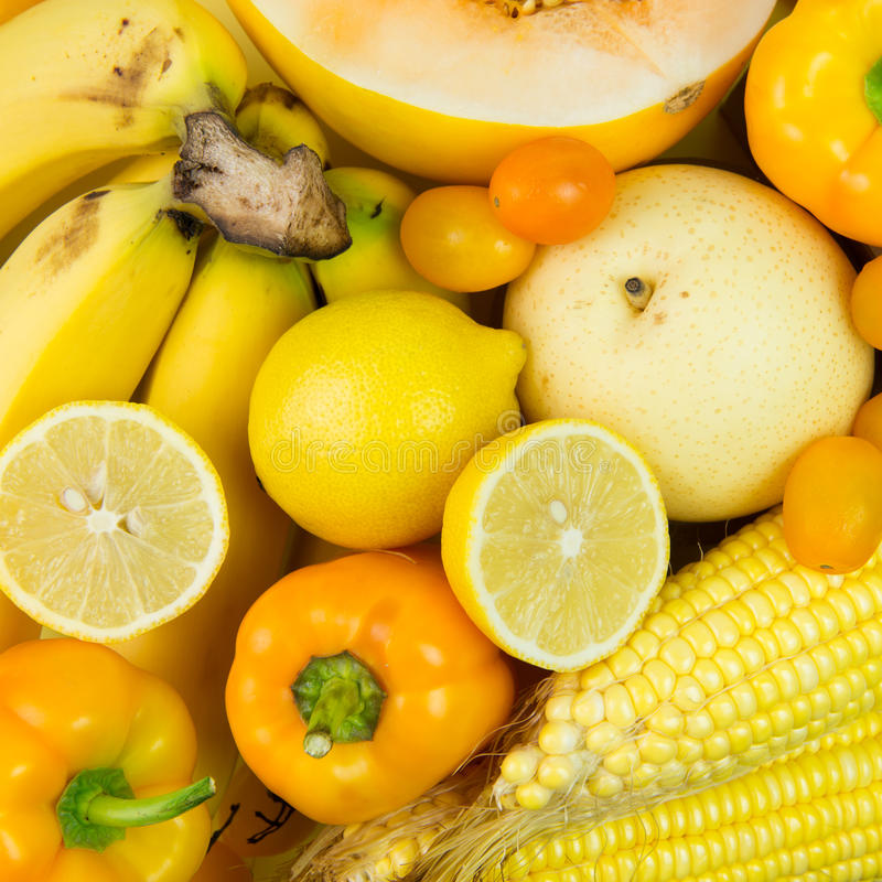Yellow vegetables and fruits royalty free stock photos