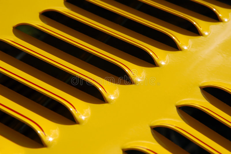 Yellow vent. Colorful sports car engine vent close-up royalty free stock image