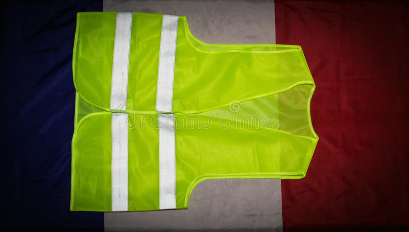 Yellow vest on French flag. Yellow vests protests  in France concept stock images