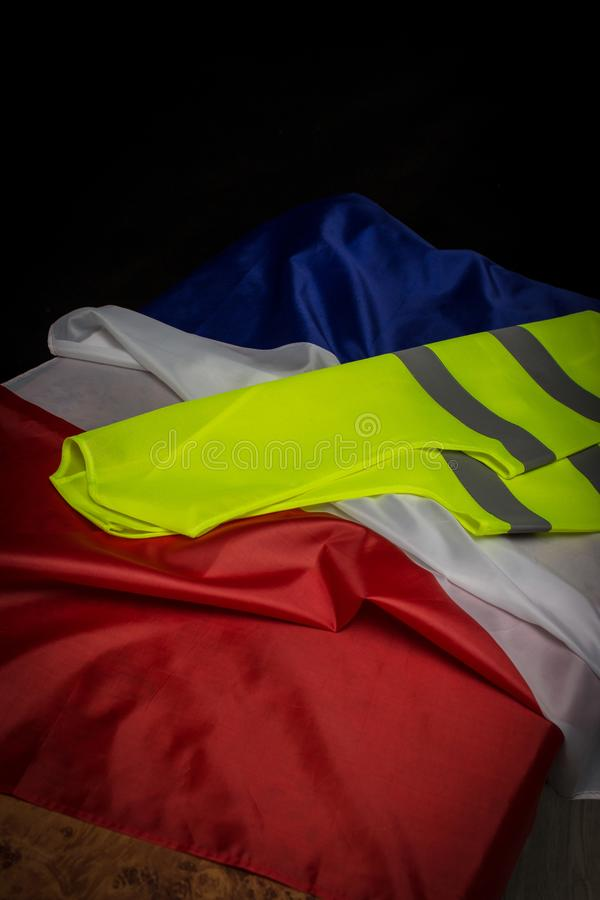 Yellow vest on French flag. Yellow vests protests  in France concept royalty free stock photography
