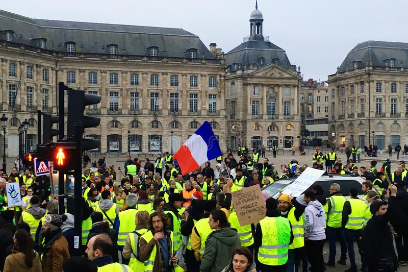 Yellow vest protests against increase taxes on gasoline and diesel introduced government of France. Bordeaux, France - December 8, 2018: yellow vest protests stock photo