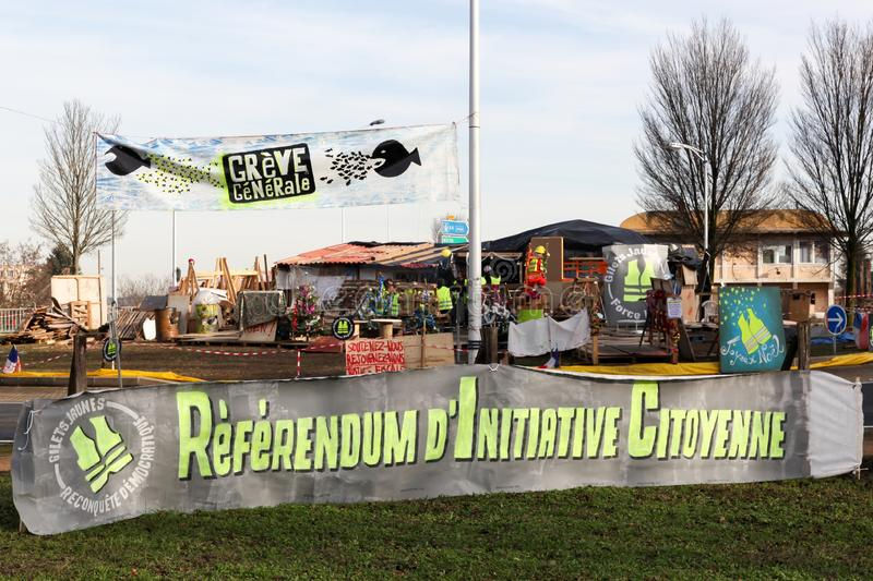 Yellow vests protest in France at a round circle and asking for the citizens initiative referendums called RIC in French. Villefranche en Beaujolais, France stock photos