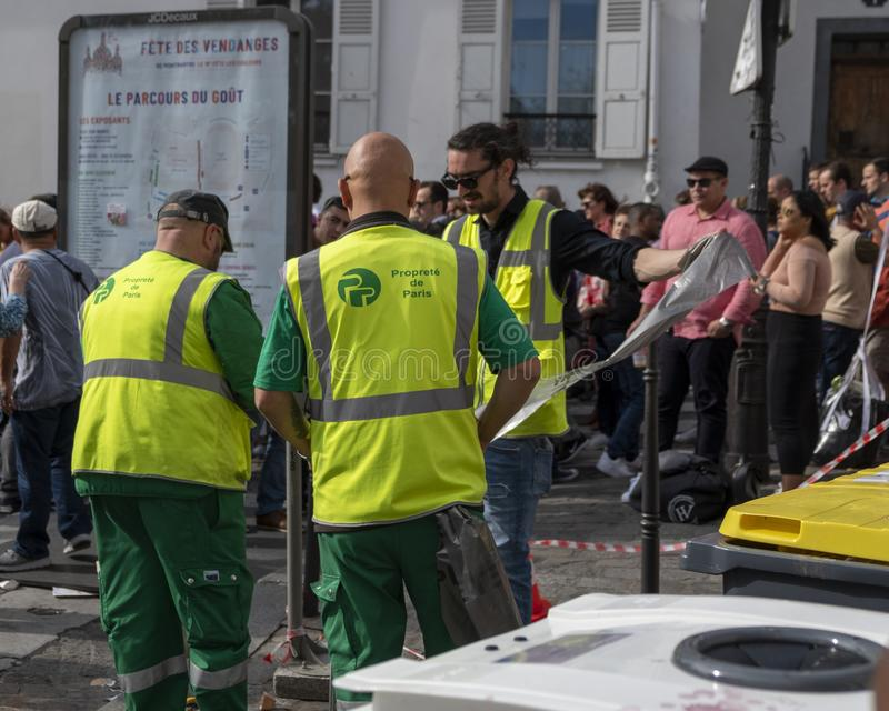 Yellow Vests providing much needed service stock photo