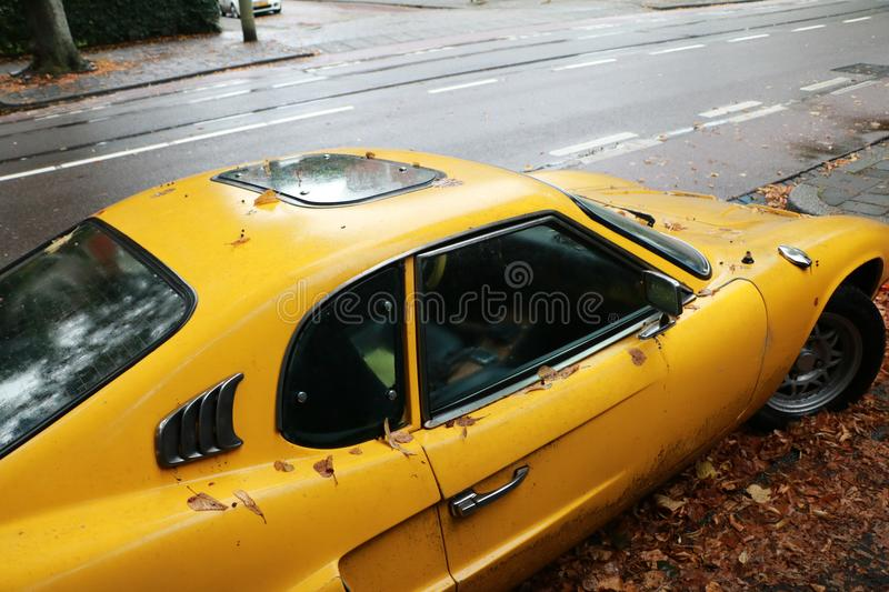 Yellow Vintage Car in Autumn stock image