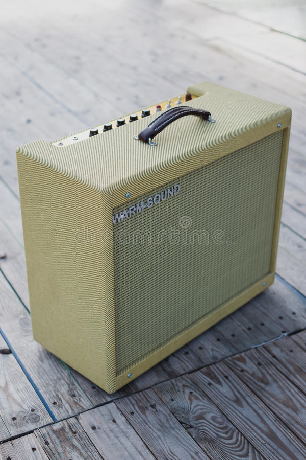 Yellow vintage guitar aplifier stock photo
