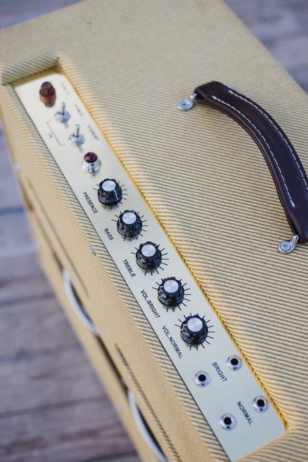 Yellow vintage guitar aplifier royalty free stock photo