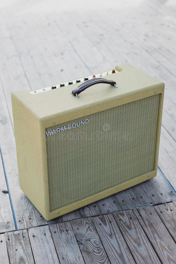 Yellow vintage guitar aplifier royalty free stock images