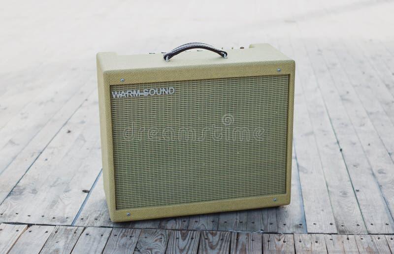 Yellow vintage guitar aplifier royalty free stock photos