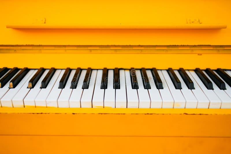 Yellow vintage piano stock photos