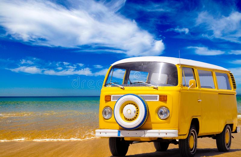 Holidays Summer Travel, Yellow Vintage Van, Sand Beach Coastline. Yellow van on a sand beach coastline. Blue bright sky with white summer clouds. Sunny day stock photos