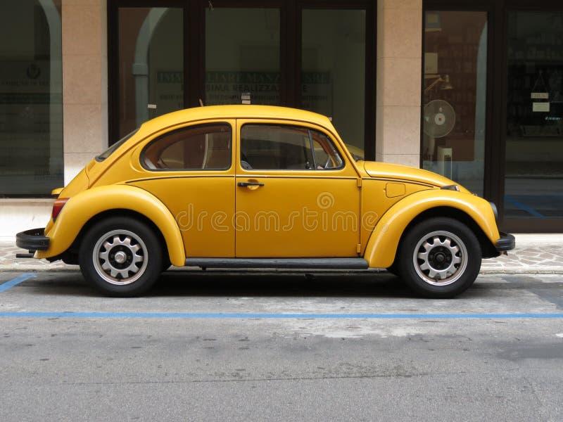 Yellow Volkswagen Beetle royalty free stock photography