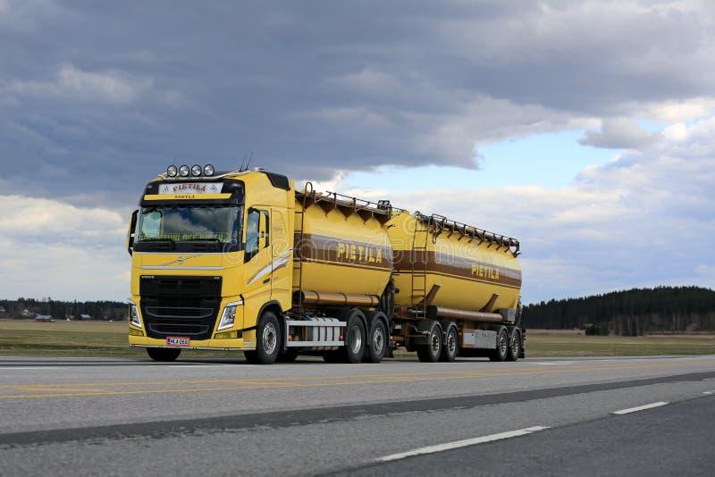 Yellow Volvo Fh Tank Truck In Bulk Transport Along Highway