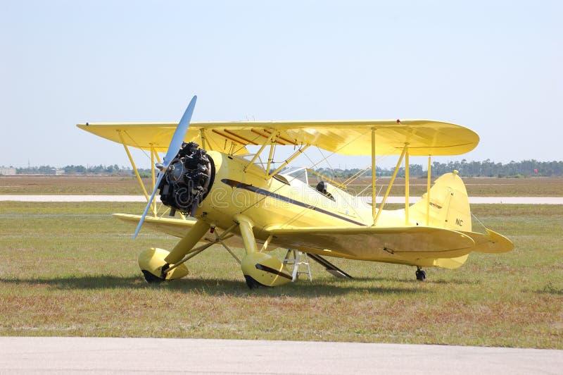 Yellow Waco Biplane. A yellow Waco biplane waits for a flight stock photos