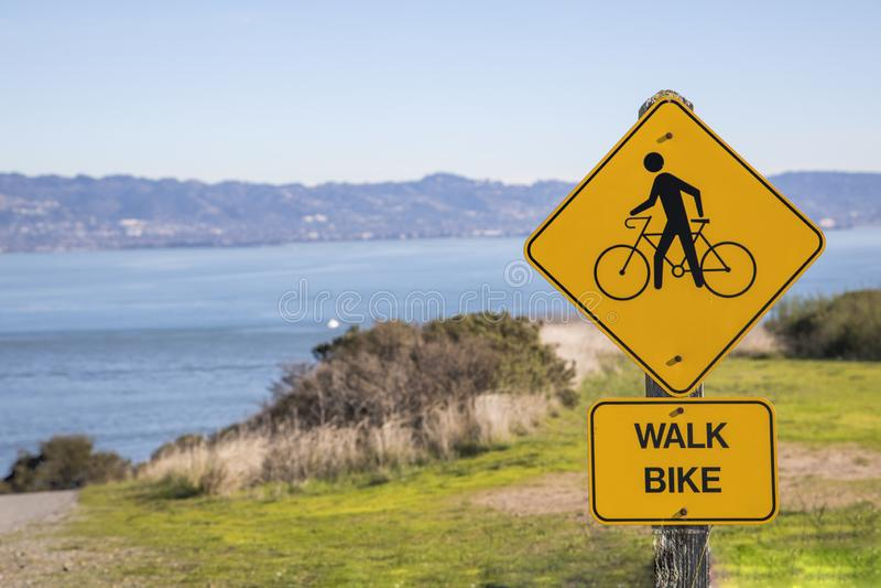 Yellow Walk and Bike Sign. A yellow walk and bike sign in Angel Island in California stock photo
