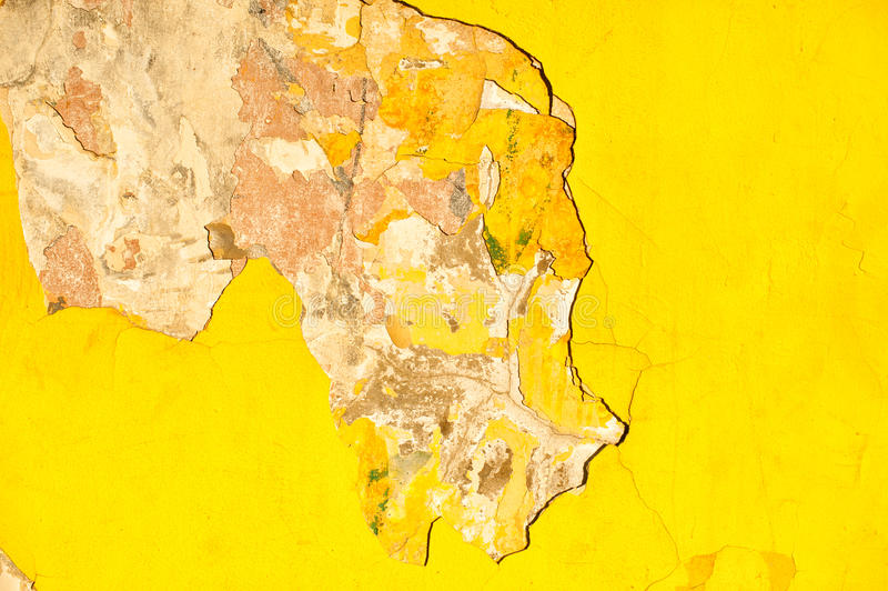 Yellow wall with peeling off the plaster royalty free stock photo