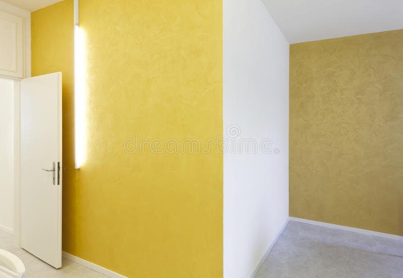 Yellow walls and neon. Empty room with yellow walls and neon royalty free stock photo