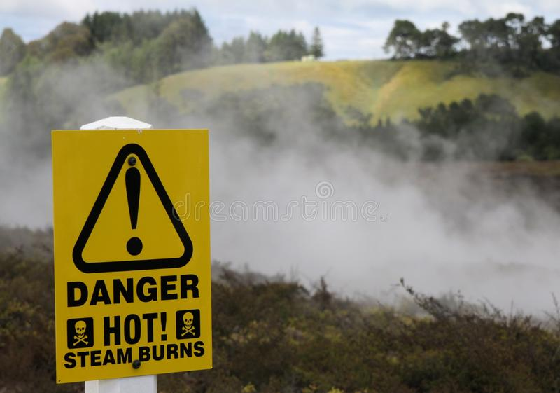 Yellow warning sign for hot steam burns at Orakei Korako Thermal Area, New Zealand stock images